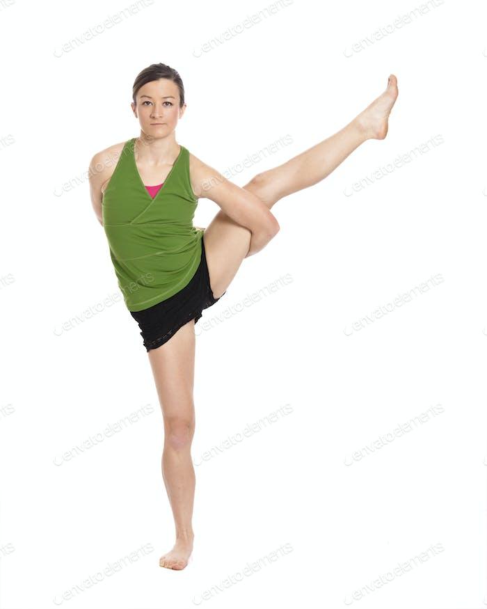 woman doing yoga, crane position