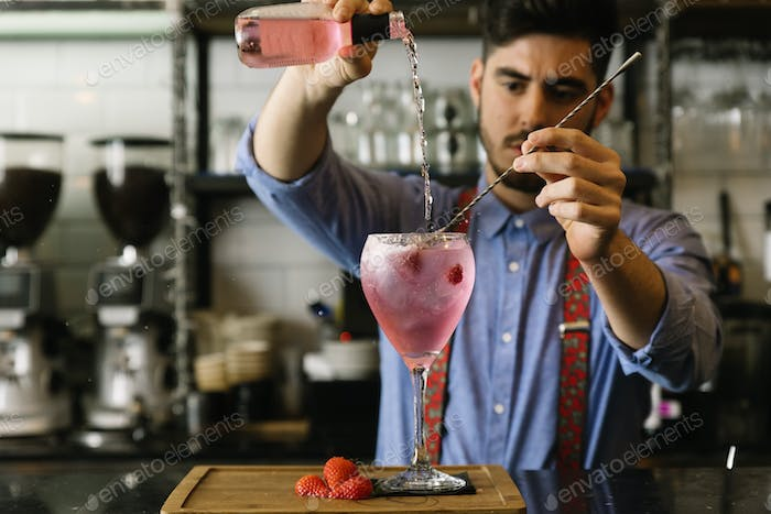 Barman is making cocktail