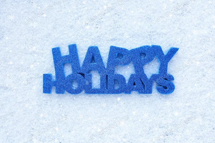 """Greeting """"Happy Holidays"""" is on snow"""