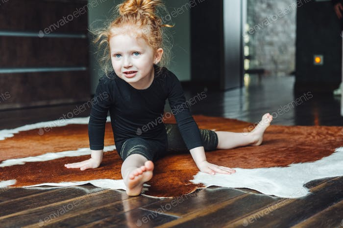 Little girl performs a twine