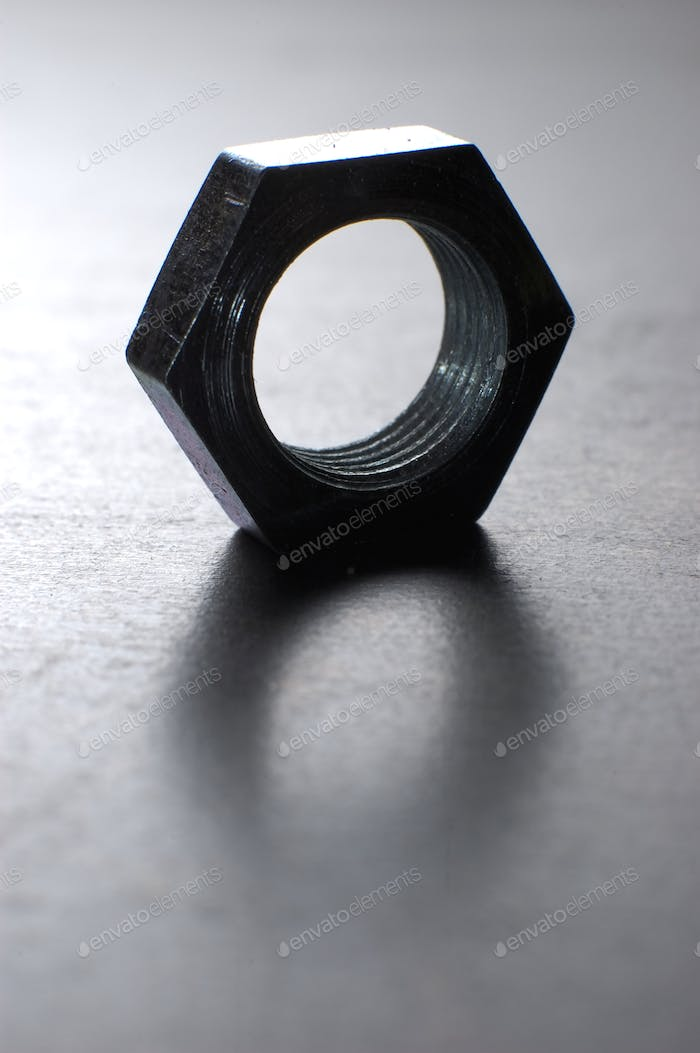 Close-up of one chrome hexagon metal nut