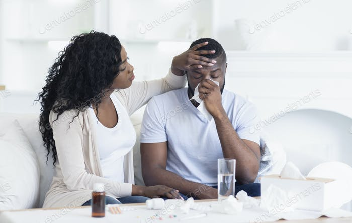 Black Woman Looking After Her Sick Husband