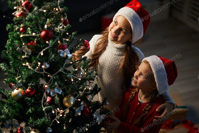 Sisters by xmas tree