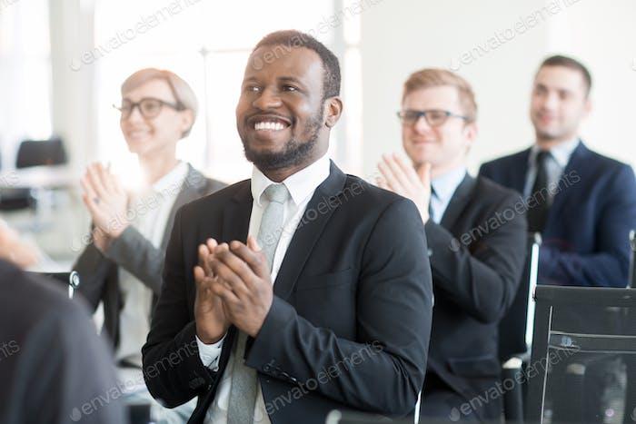 Applauding to speaker