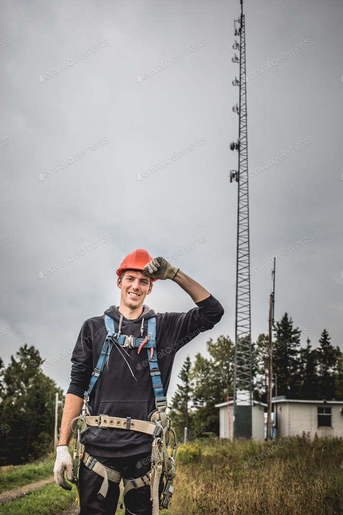 Telecom Technician man in uniform with harness