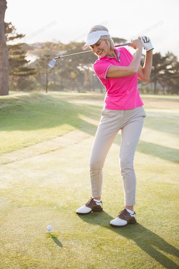 Sportswoman playing golf