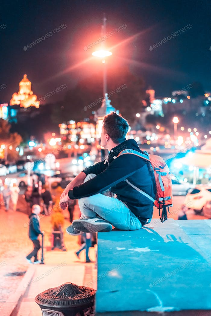 Guy on the background of the Tbilisi.
