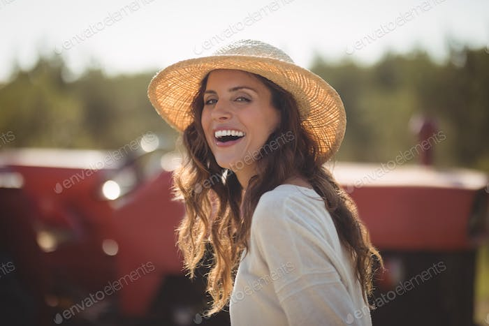 Portrait cheerful young woman wearing sun hat
