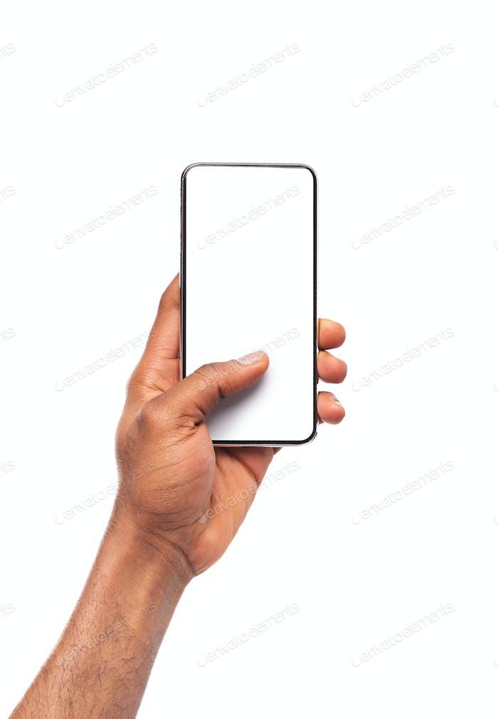 Black male hand showing blank screen of modern smartphone