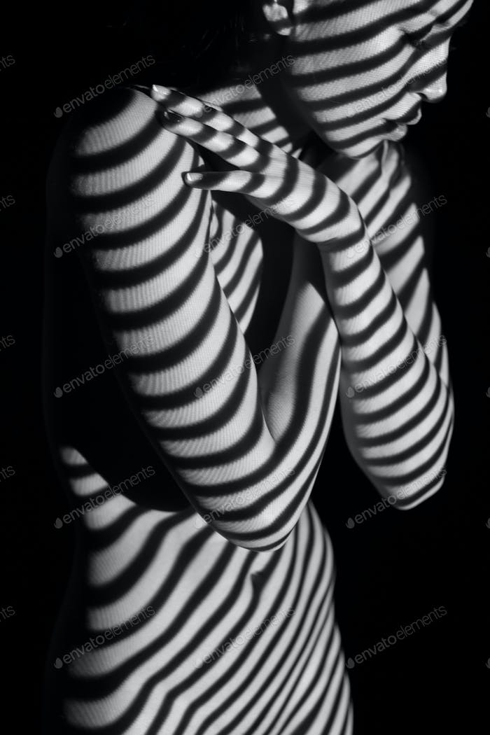 The  body of woman with black and white zebra stripes