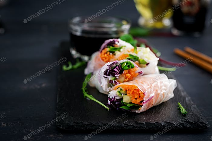 Vegetarian vietnamese spring rolls with spicy shrimps, prawns,  carrot, cucumber