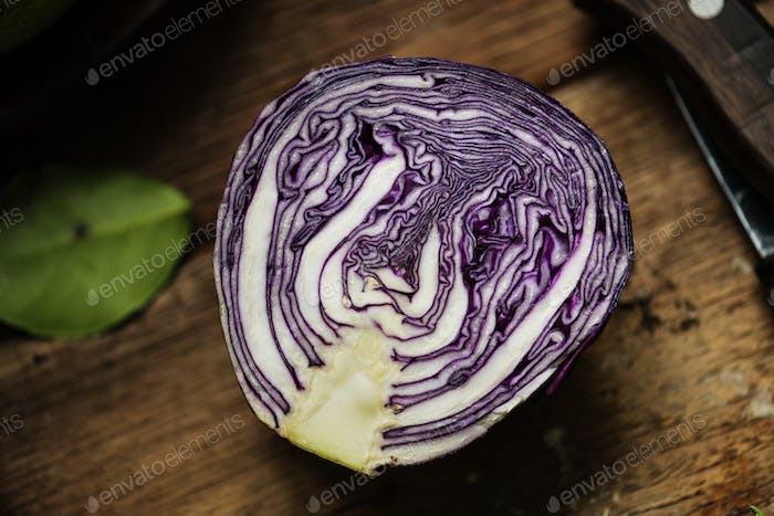 Closeup of fresh cut organic red cabbage on wooden table