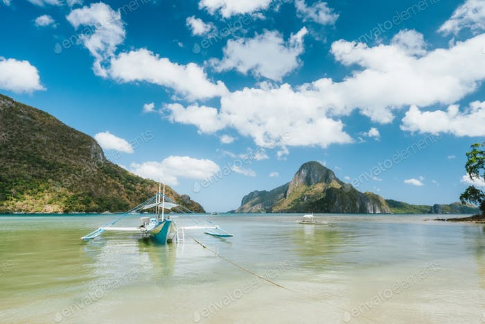 Boat in El Nido bay and Cadlao island, Palawan, Philippines