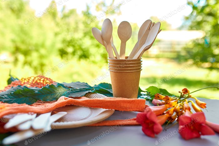 Flat lay of eco craft paper and wooden tableware, Zero waste