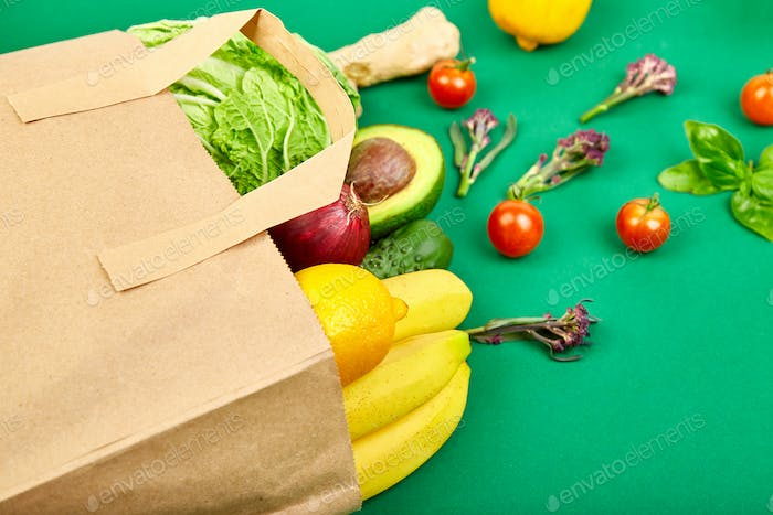 Grocering concept. Full paper bag of different fruits