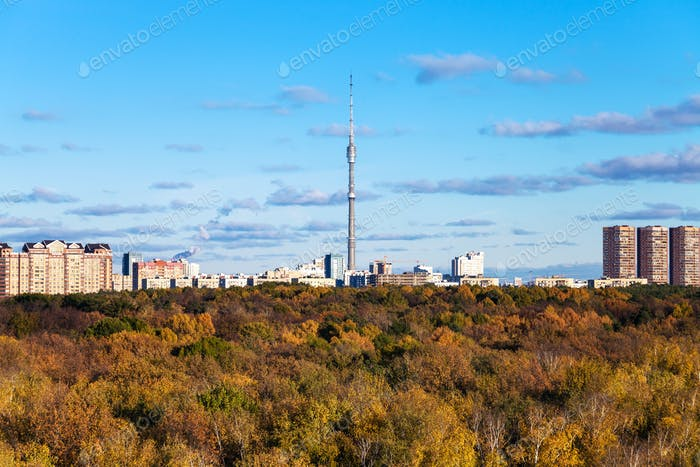 autumn landscape with woods and city with tv tower