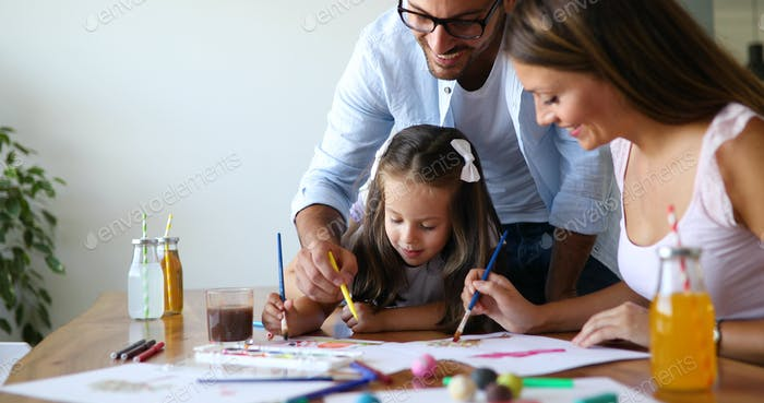 Mom and dad drawing with their daughter