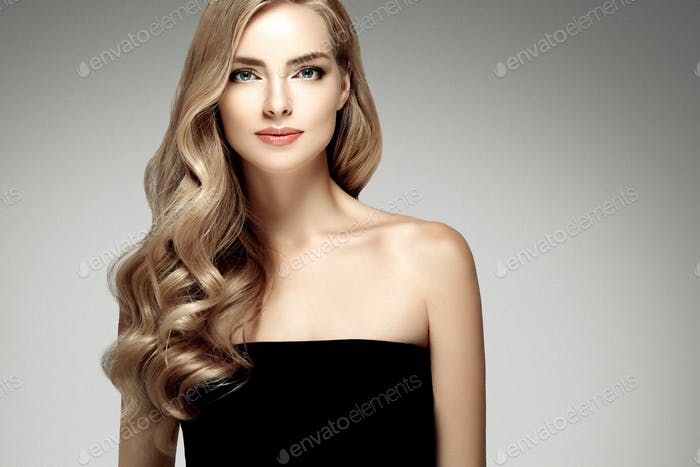 Amazing woman hair portrait. Beautiful girl long wavy hairstyle