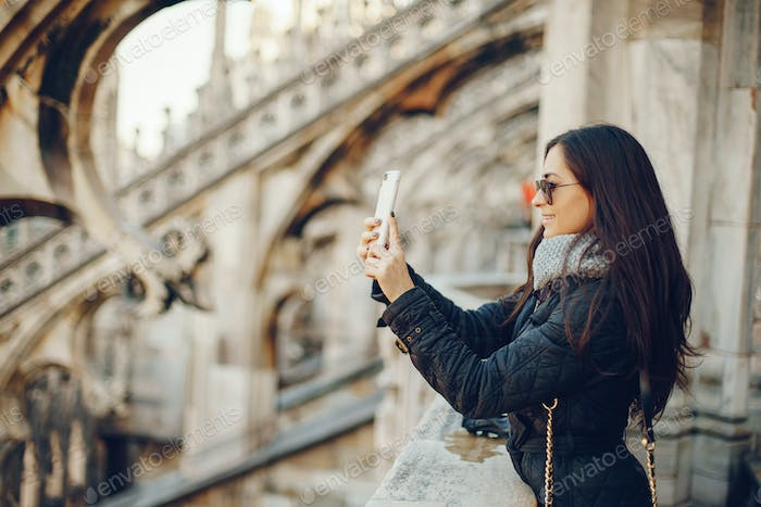 girl using her phone while exploring Milan Italy