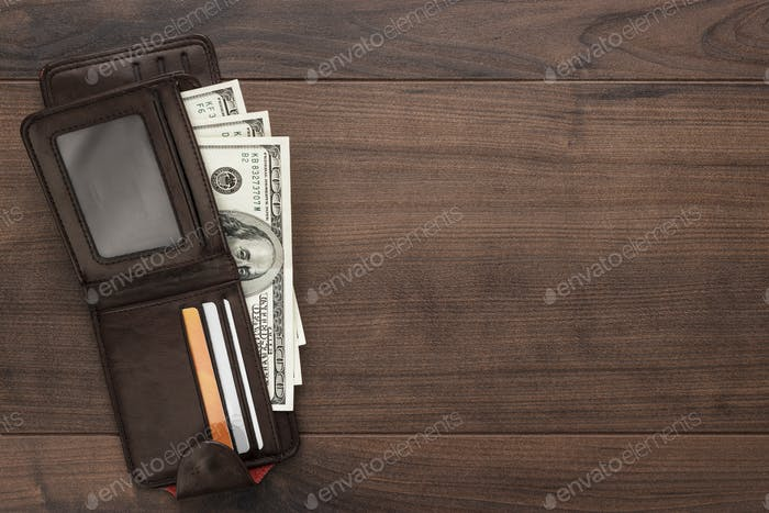 Purse With Money On The Wooden Table