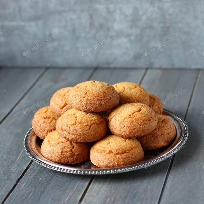 "Dutch almond cookies called ""bitterkoekjes"" on metal plate"