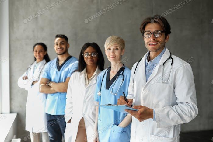 Multiracial team of newest modern clinic having breefing
