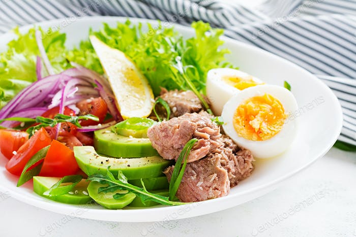Tuna fish salad with eggs, lettuce, cherry tomatoes, avocado and red onions