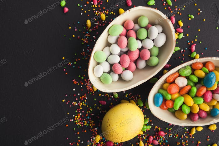 Chocolate eggs and colorful candies