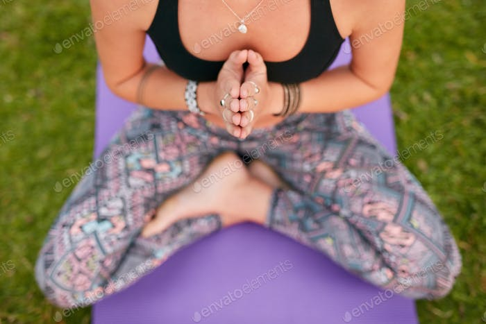 Determined woman practicing yoga outdoor