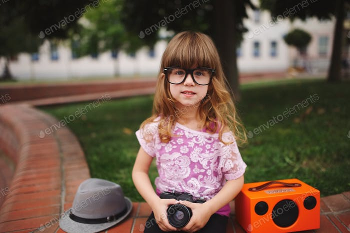 little hipster girl with big glasses