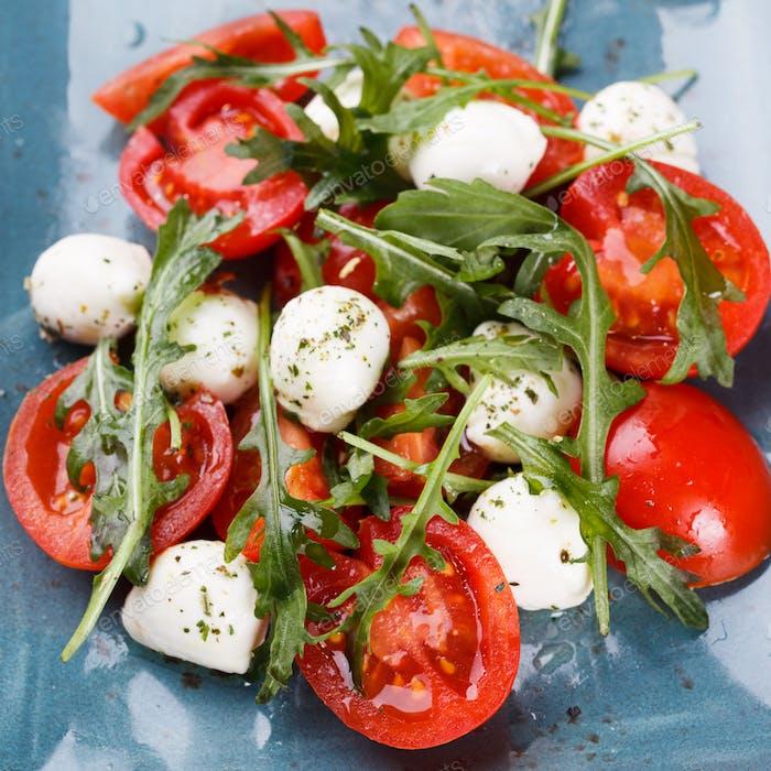 Vegetable salad,cherry tomatoes,, mini mozzarella, arugula