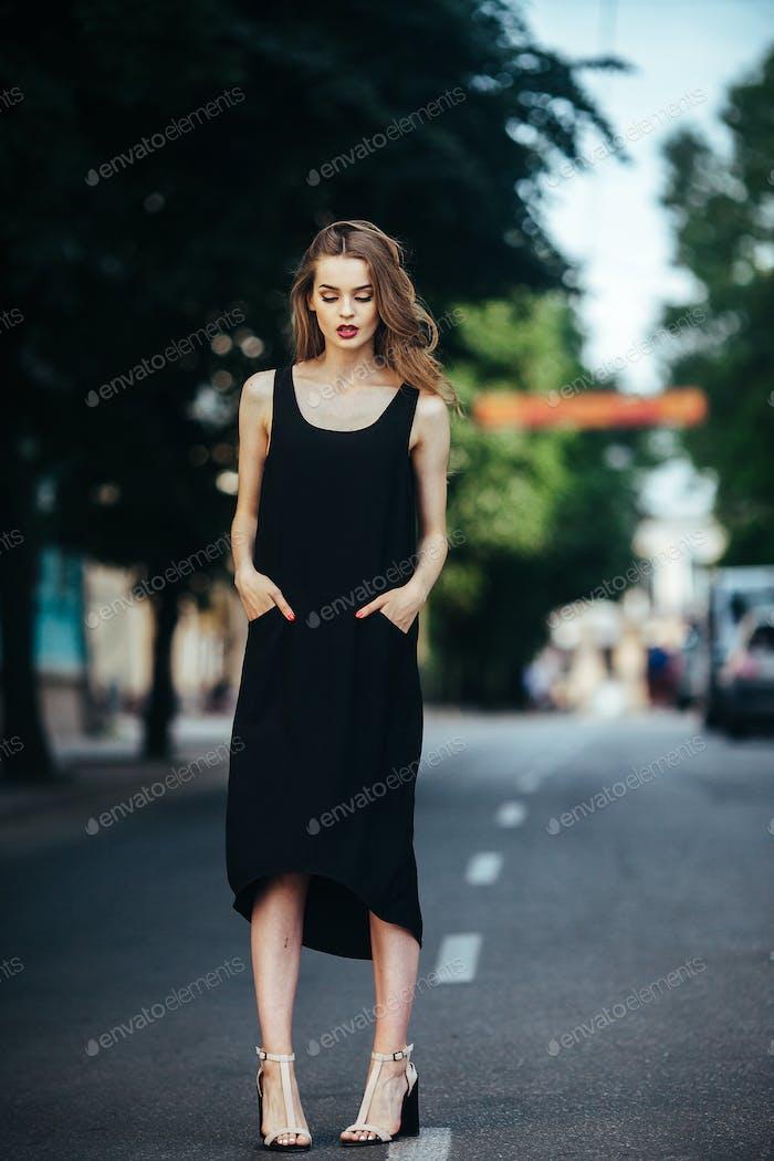 pretty girl posing in a city street