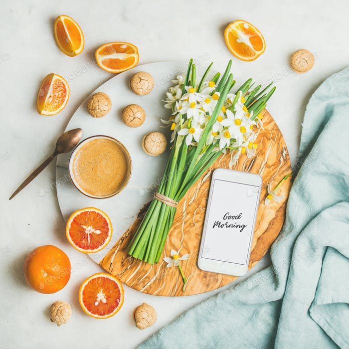 Coffee, cookies, oranges, flowers and mobile phone with Good morning