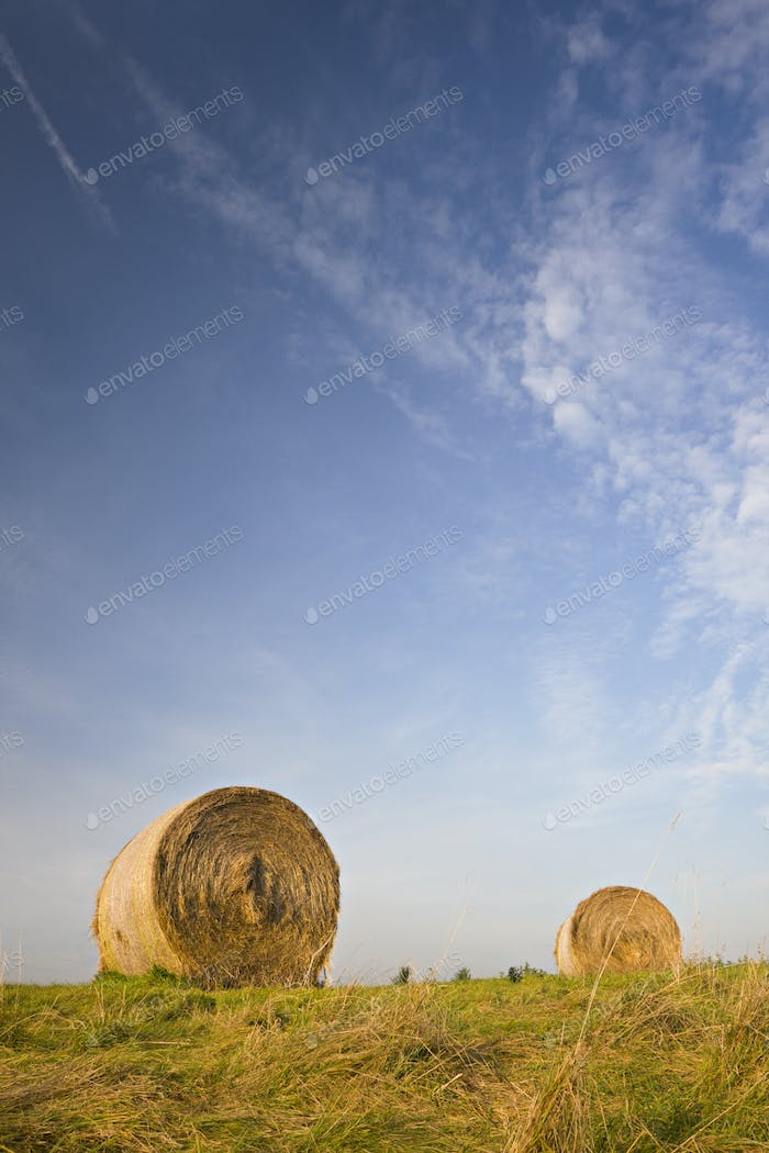 Hay Bales Under Blue Sky