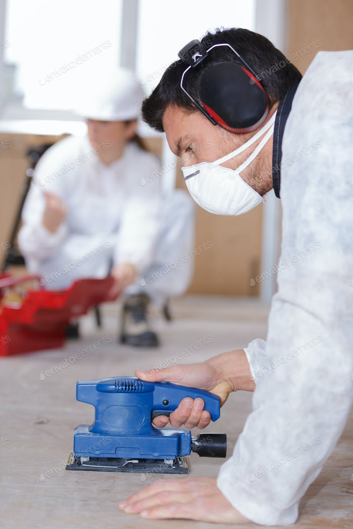 Man wearing protective equipment while working
