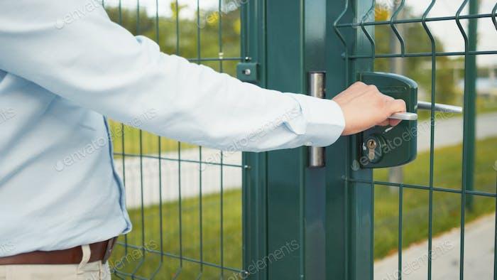 Young man opening the door