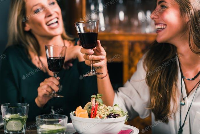 Healthy Eating. Female Friends in Vegetarian Restaurant Eating,