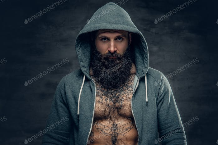 Athletic bearded male in a grey hoodie.