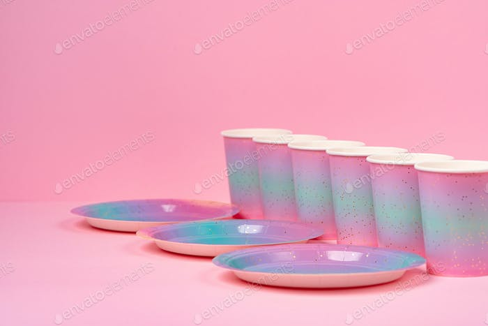 Pink party cups and plates on pink background