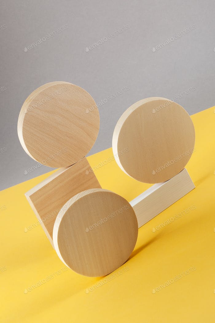 Abstraction from round wooden geometric figures on a gray-yellow