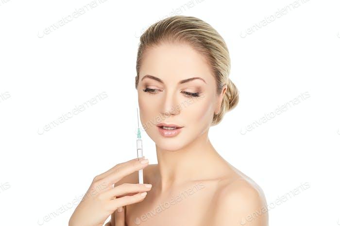 beautiful girl holding syringe isolated on white