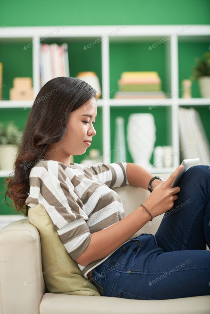 Young Woman Reading Interesting Book