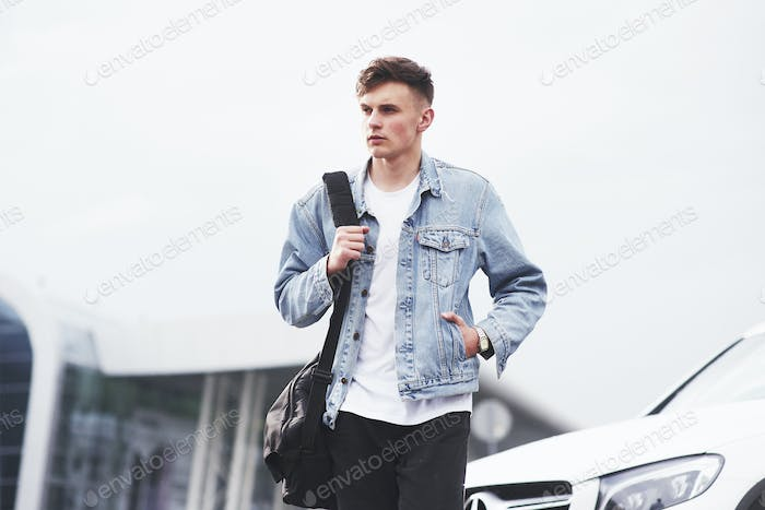 Young boy in a blue denim jacket on the street