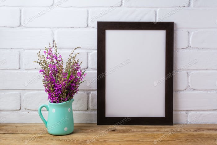 Black brown  frame mockup with maroon purple flowers in mint pit