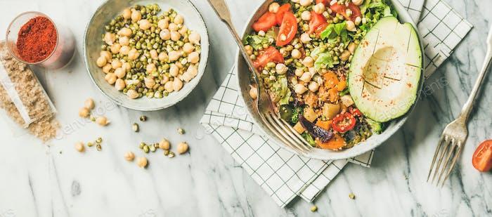 Vegan dinner bowl with avocado, grains, beans and fresh vegetables