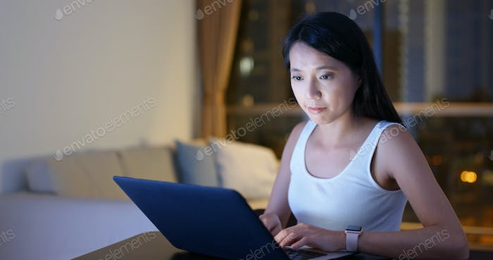 Woman study on laptop at home in the evening