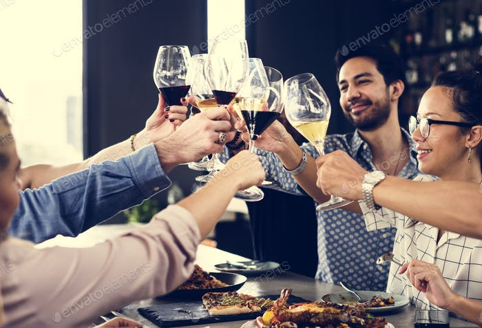 People toasting at a meal