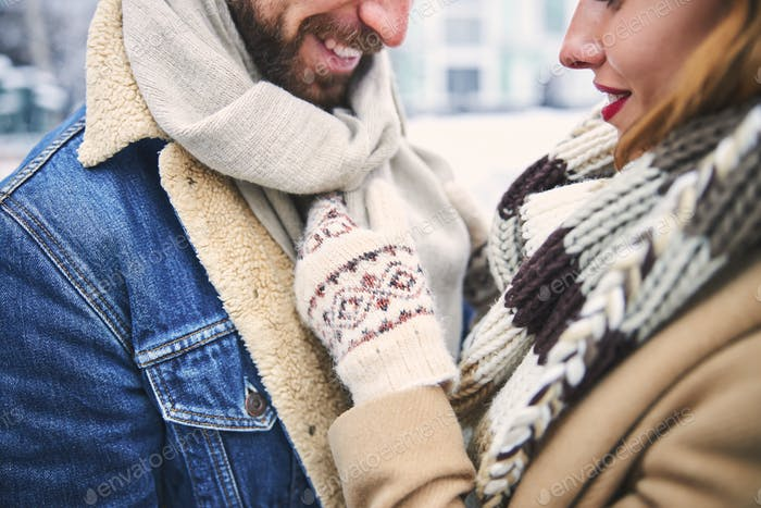 Romentic moments of young couple in winter