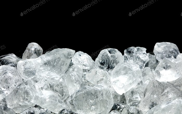 heap of ice on black background