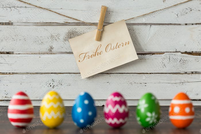 Easter eggs against wooden wall